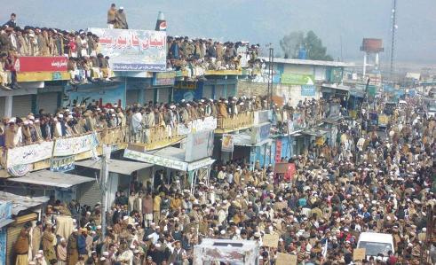 Thousands turn up to demonstrate against army operations fighting America's 'War on Terror' in Swat