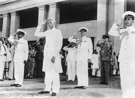 Muhammad Ali Jinnah taking the salute at a military march past in Karachi, having been sworn in as the first Governor General of the Muslim Dominion of Pakistan, Aug. 17 1947.
